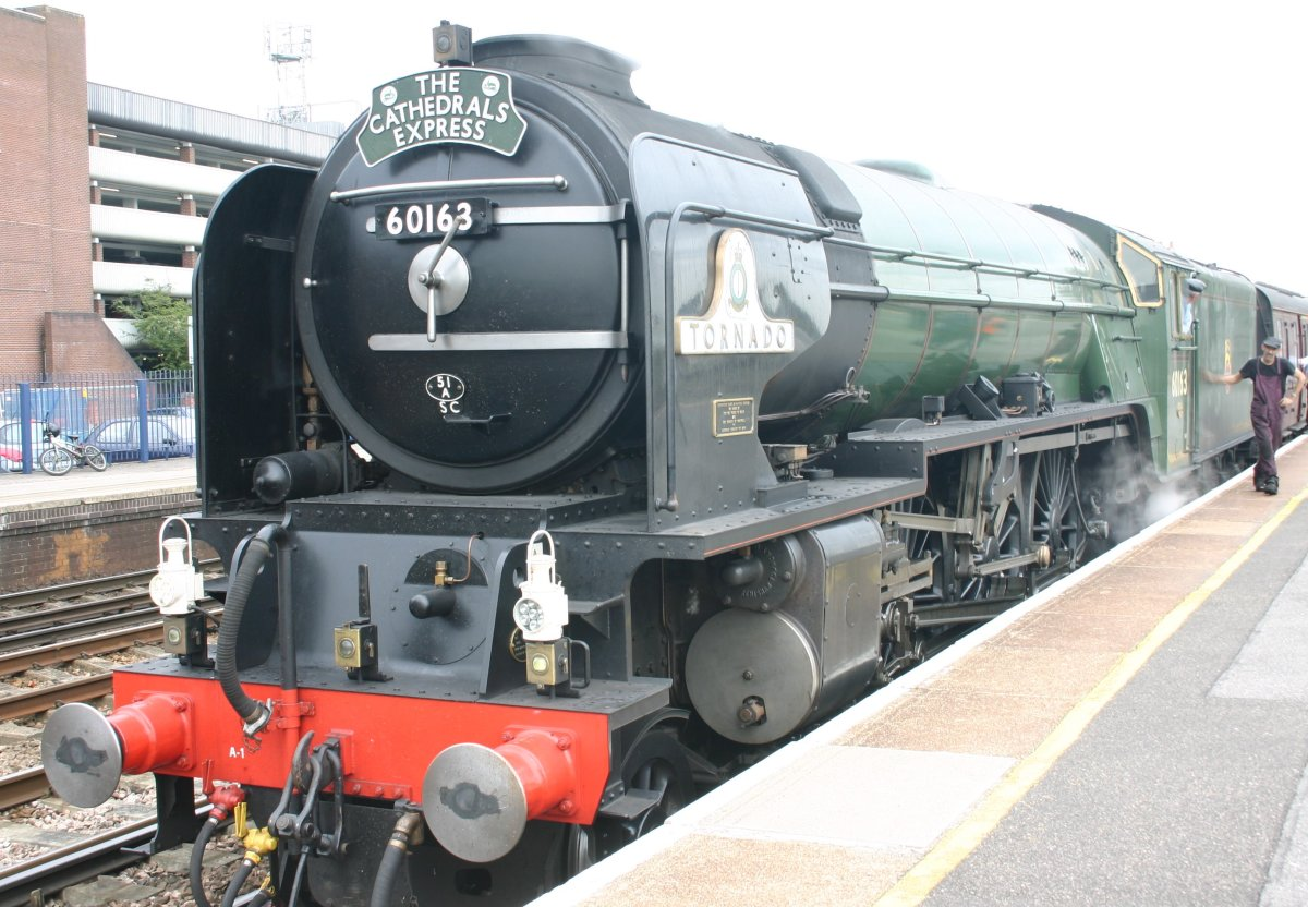 """Build year 2008 and in BR Brunswick Green, looking for all the world as if she belonged to another era, 60163 'Tornado' stands at Eastleigh (Hampshire) with the 'Cathedrals Express"""""""