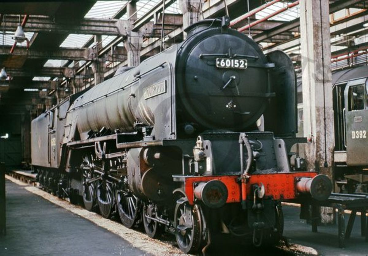 Seen here later in life with the late 1950s BR lozenge totem on her tender,  60152 'Holyrood' stands appropriately in one of the Scottish sheds with the sun streaming through the shed roof