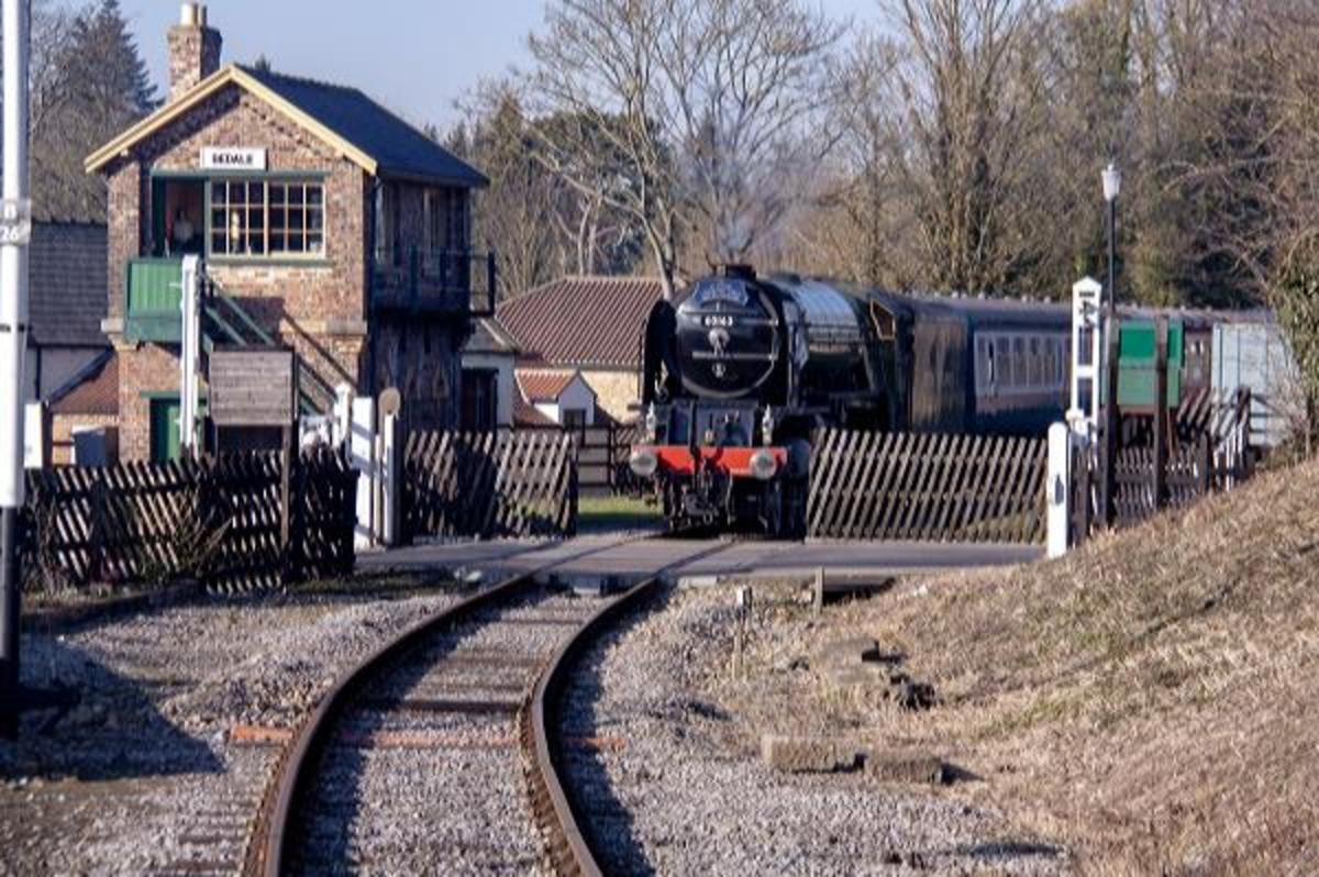 'Tornado' passes the level crossing at Bedale on her way with a train back to Leeming Bar