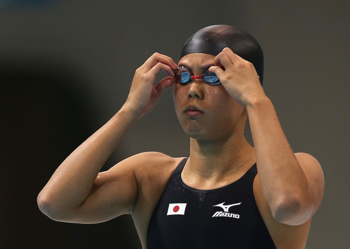 Natsumi Hoshi adjusts her goggles prior to the second heat of the 200 meter Women's Butterfly swimming competition in the 2012 Summer Olympics in London, England.