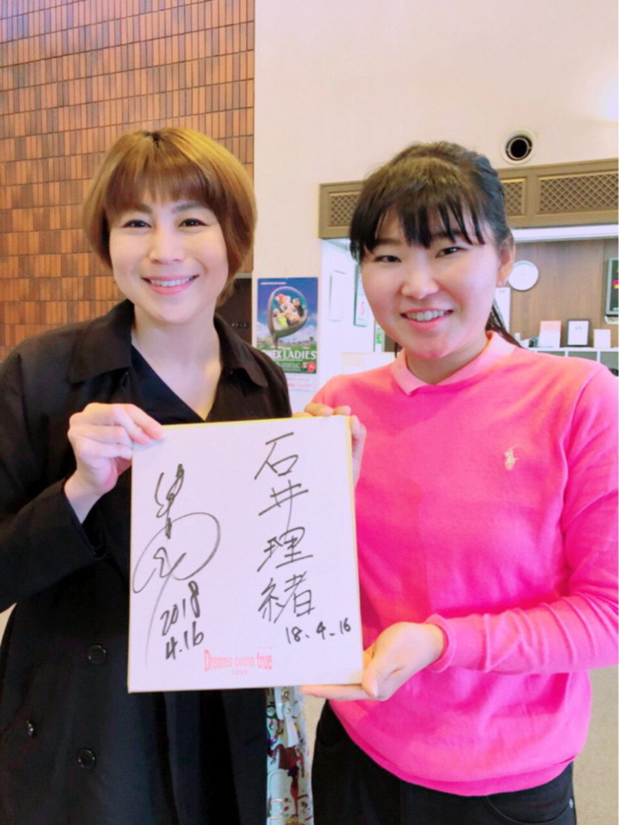 With golf player Rio Ishii (right).