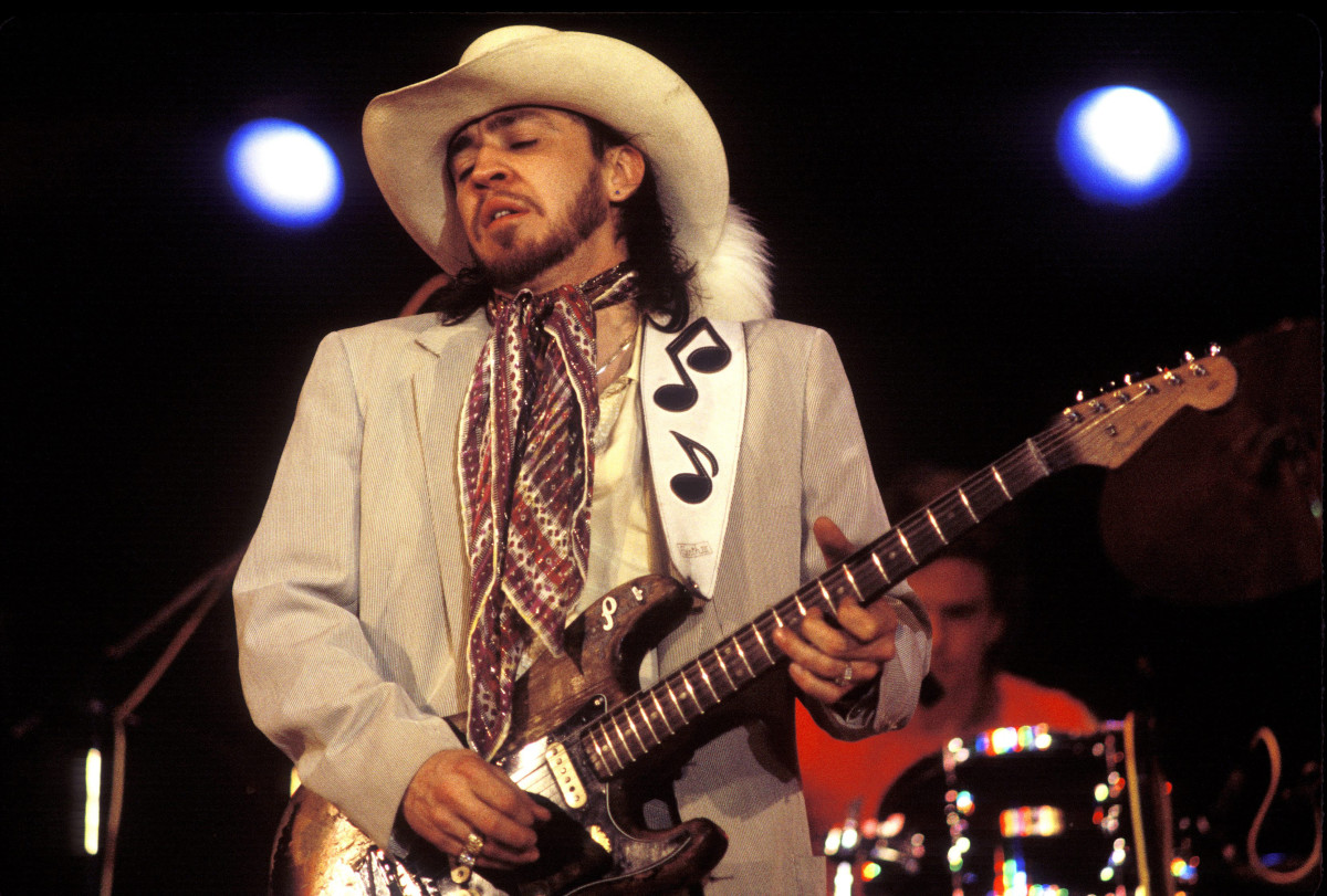 Stevie Ray Vaughan playing at concert