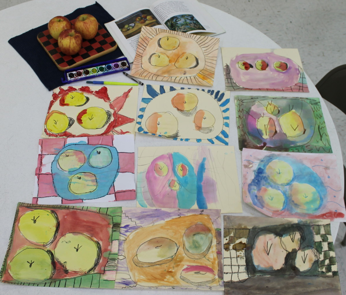 Some of the finished still ife paintings of apples inspired by Paul Cezanne