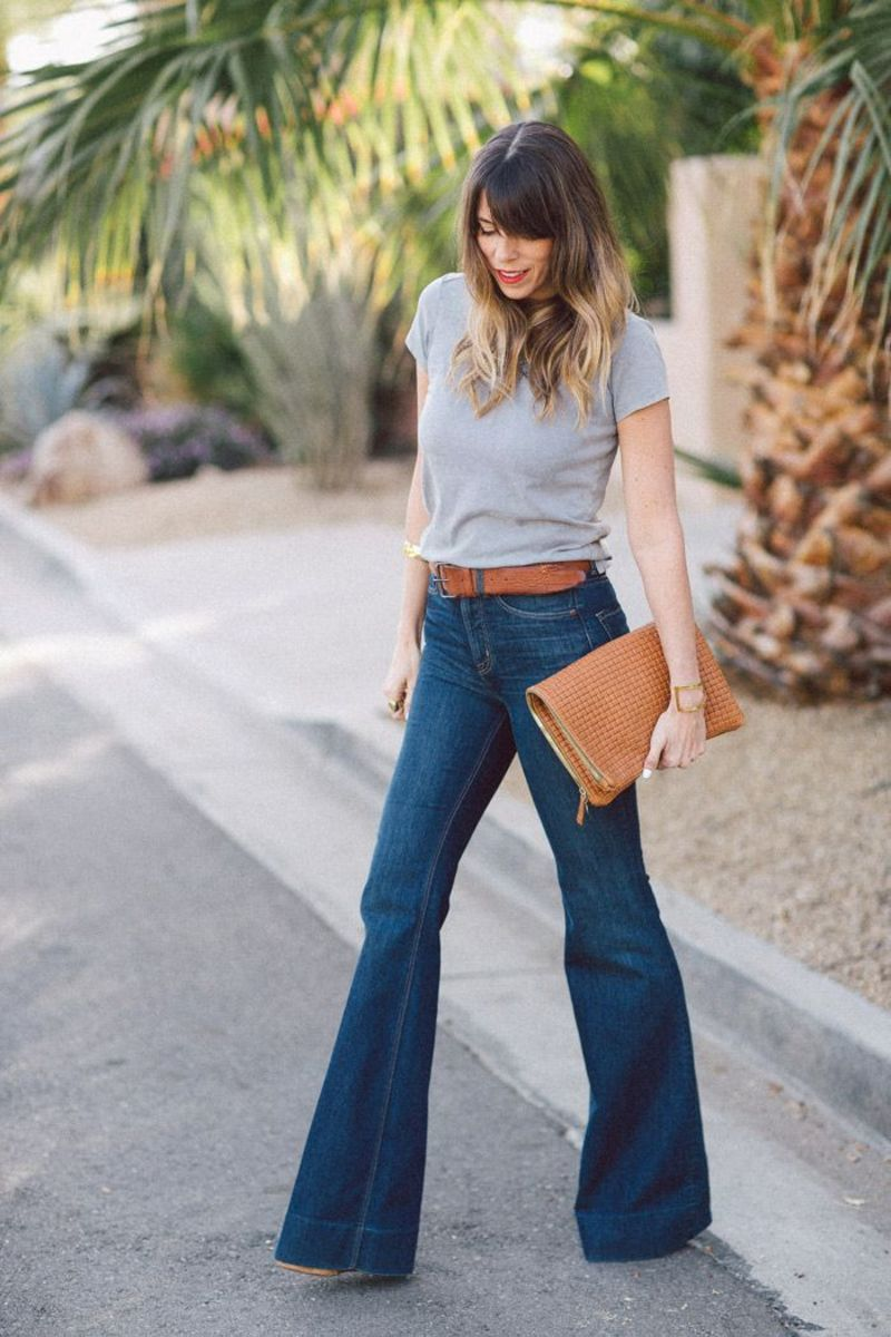 Flared jeans paired with tucked in shirt...