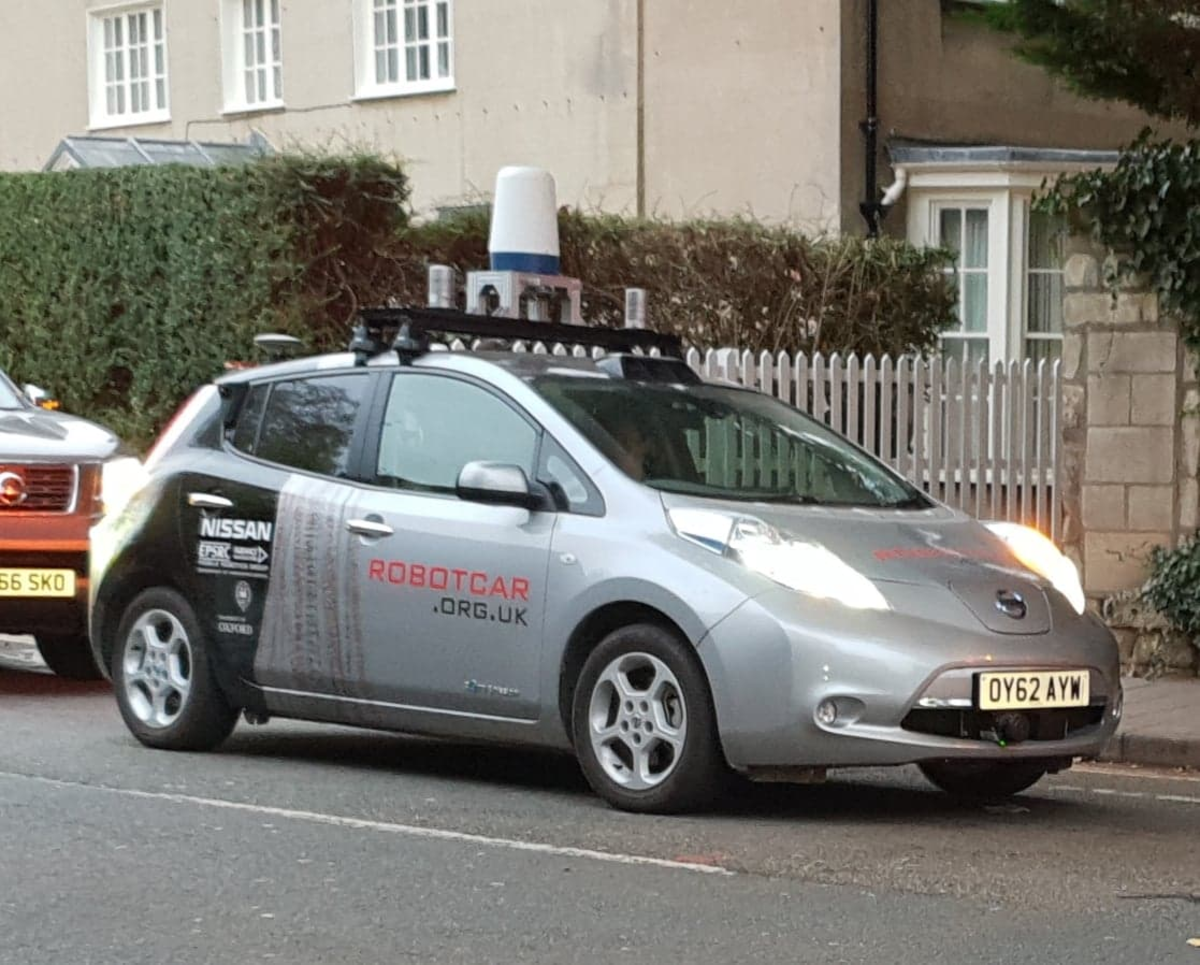 Modified Nissan Leaf used for research by the Mobile Robotics Group, Oxford Robotics Institute. Shown on the streets of Oxford, United Kingdom, the robot car has sensors that include radar, LIDAR, and cameras.