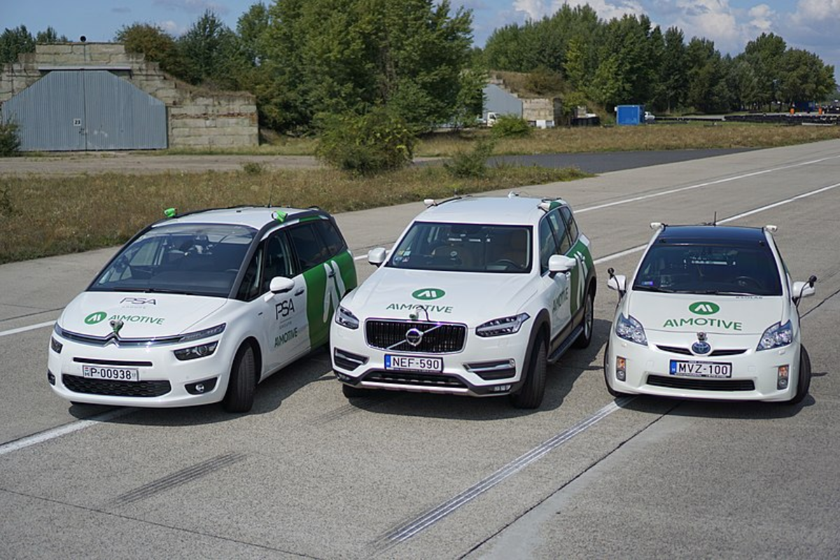 Shown above are three AImotive test vehicles, including (from left) a Citroen C4 Picasso, a Volvo XC90 and a Toyota Prius.