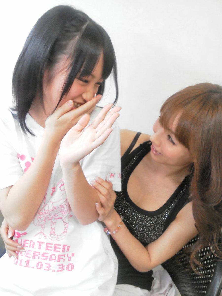 Megumi Ohori (right) is pictured here with now former member of AKB48 Rina Kawaei as she is having what looks like a good time with Rina as they both share a laugh together.