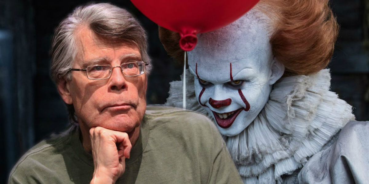 Stephen King along with the poster of IT