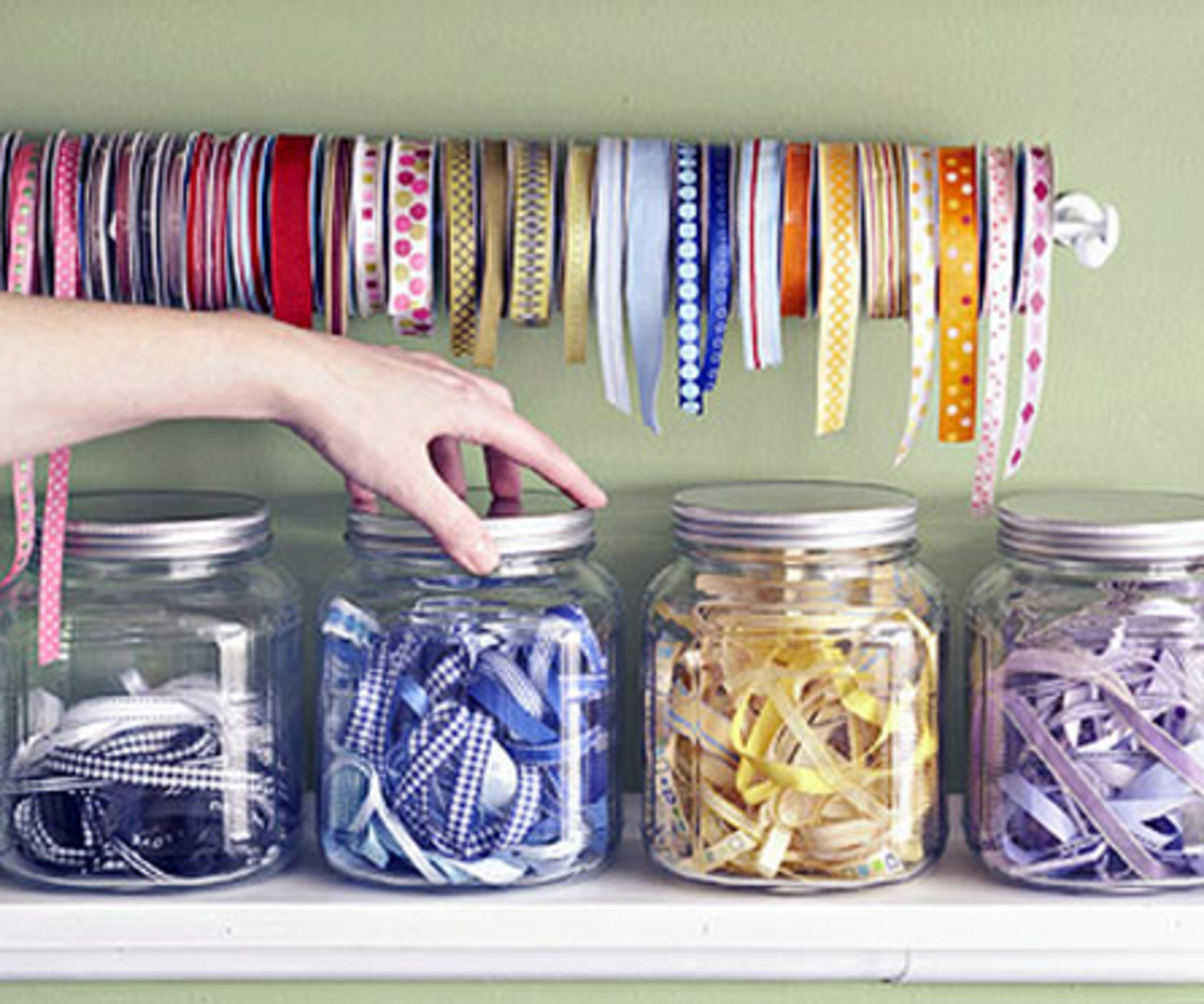 Create colorful jars of ribbon on a shelf to create a storage solution for your collection