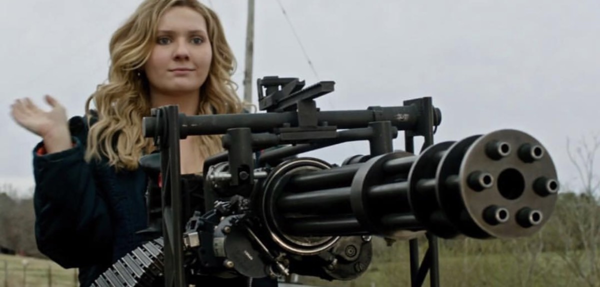 Girl and a gun.