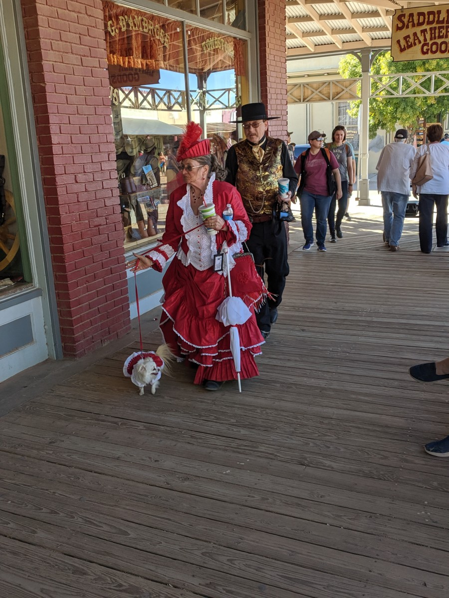 This couple and their dog, all elegantly dressed in period clothing travel frequently from their home in Nevada to participate in Tombstone festivals.