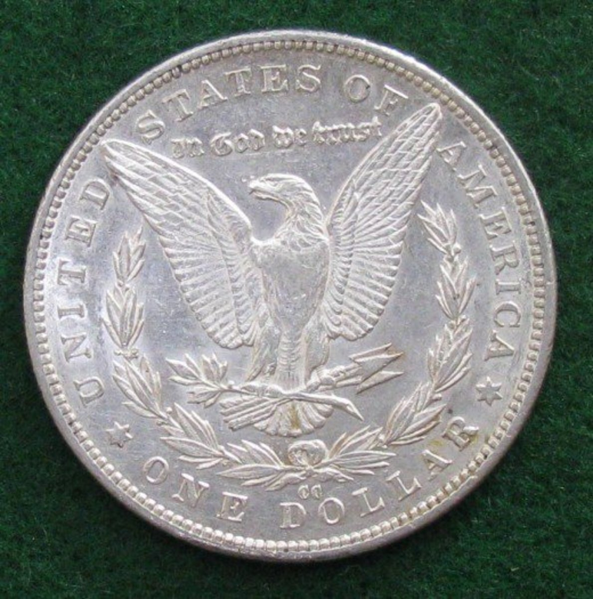 Reverse of Morgan Dollar showing the CC mint mark below the eagle.