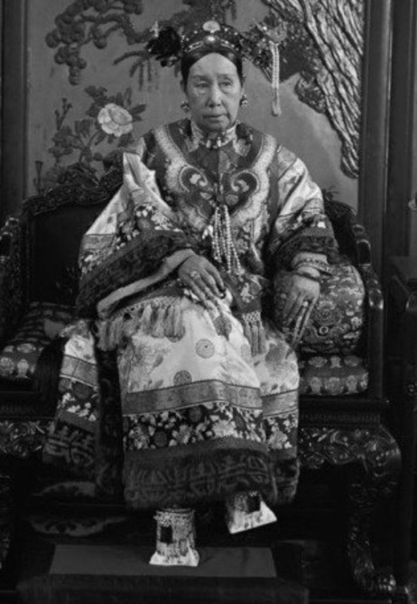 CiXi and her square cut shoes.  Most of her court shoes looked uncomfortable in a number of pedestal heel designs but she also wore moccasin type shoes.