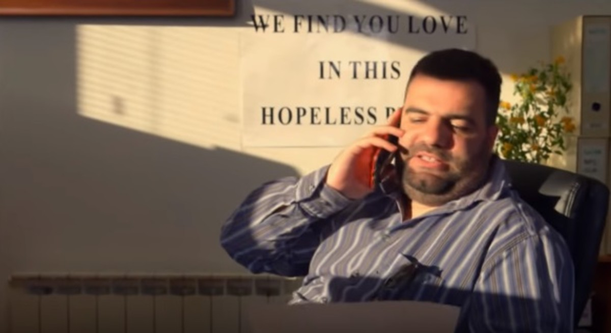 JasaVukovic as Sergei, the owner of Sergei's Matchmaking Services.