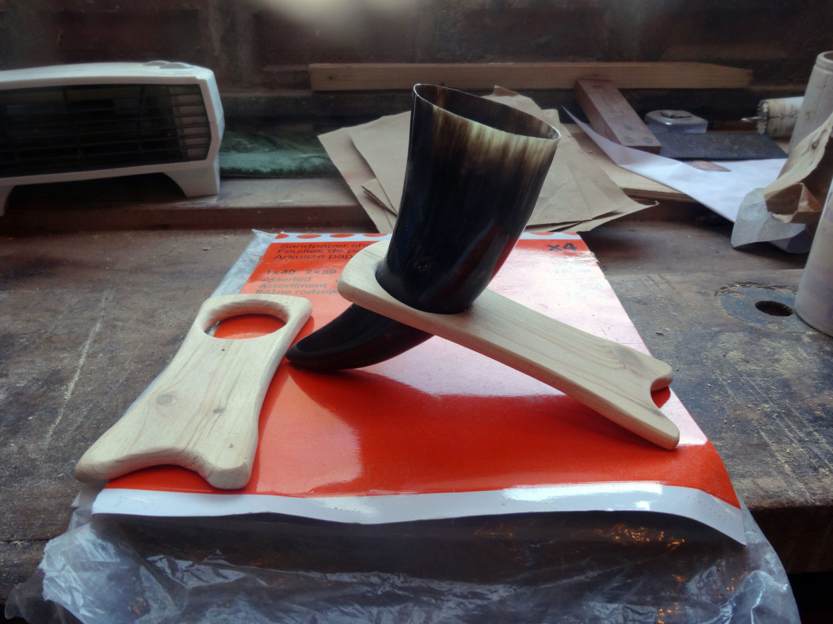 The Viking drinking horn in its stand after hand sanding.