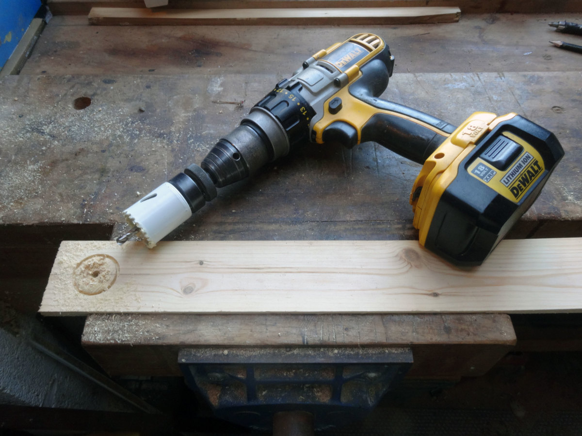 Hole saw cutter attached to the electric drill.