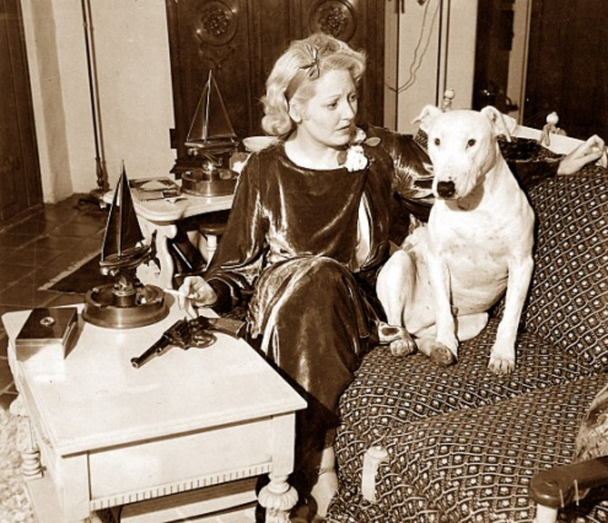 Thelma and her pit bull Nibs after she bought a gun to protect herself.
