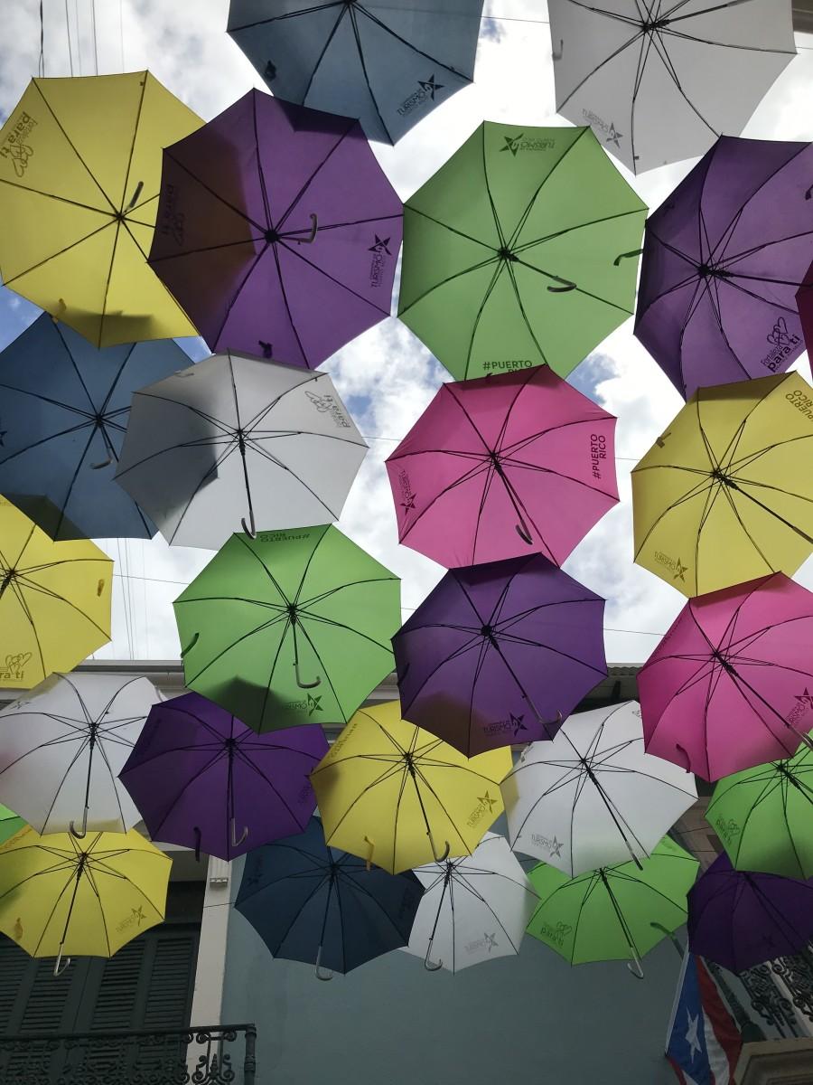 Old San Juan's iconic colorful umbrellas on Fortaleza Street.
