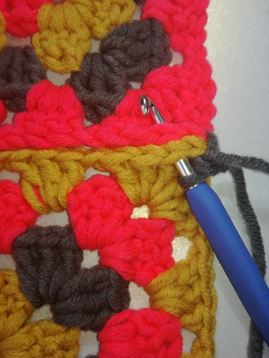 Image 2. Insert hook in the next stitches of both granny squares & work the next double crochet.