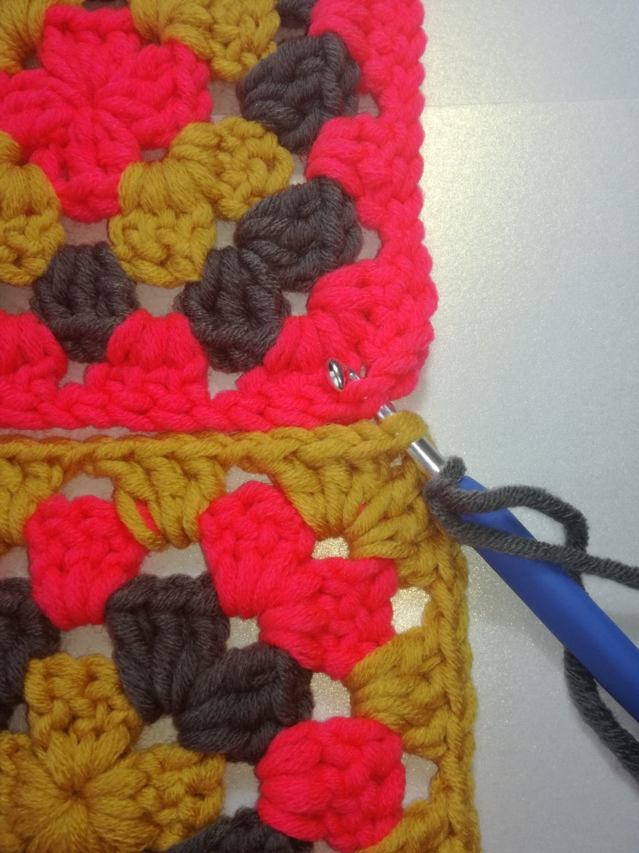 Image 1. Insert hook in the second stitches of both granny squares of the 2 chain corner & work a double crochet.