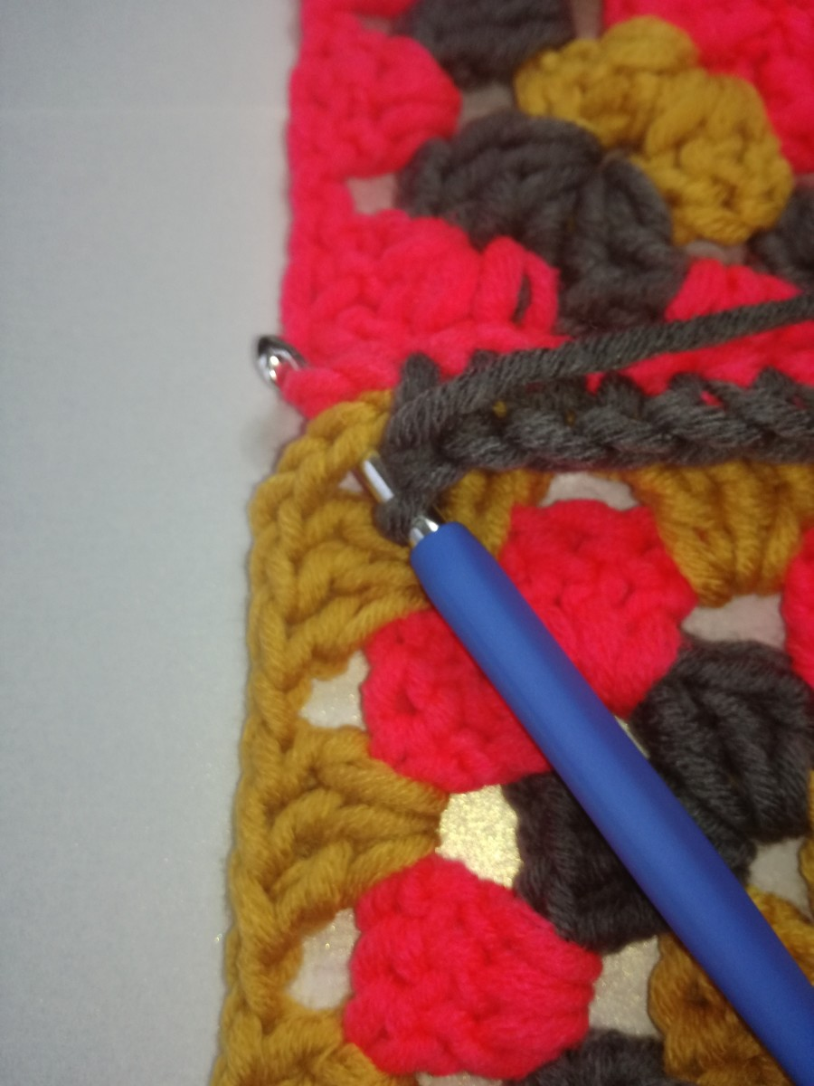 Image 3. When you get to the end of the row insert hook in the first stitch of the 2 chain corner and make the last double crochet.