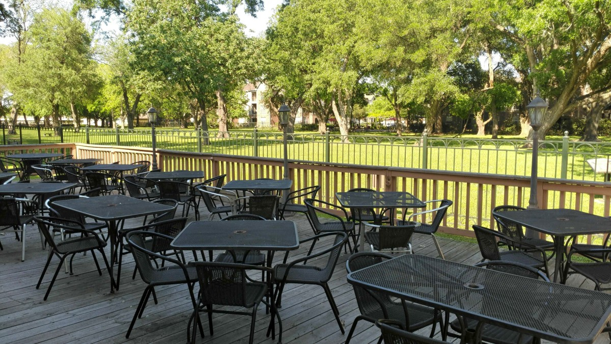 The outdoor eating area of the restaurant overlooking the park