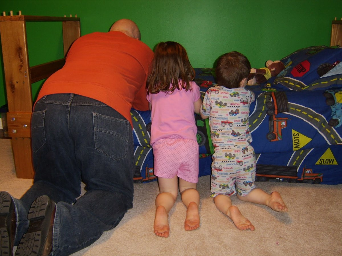 A Father Teaches his Children to Pray