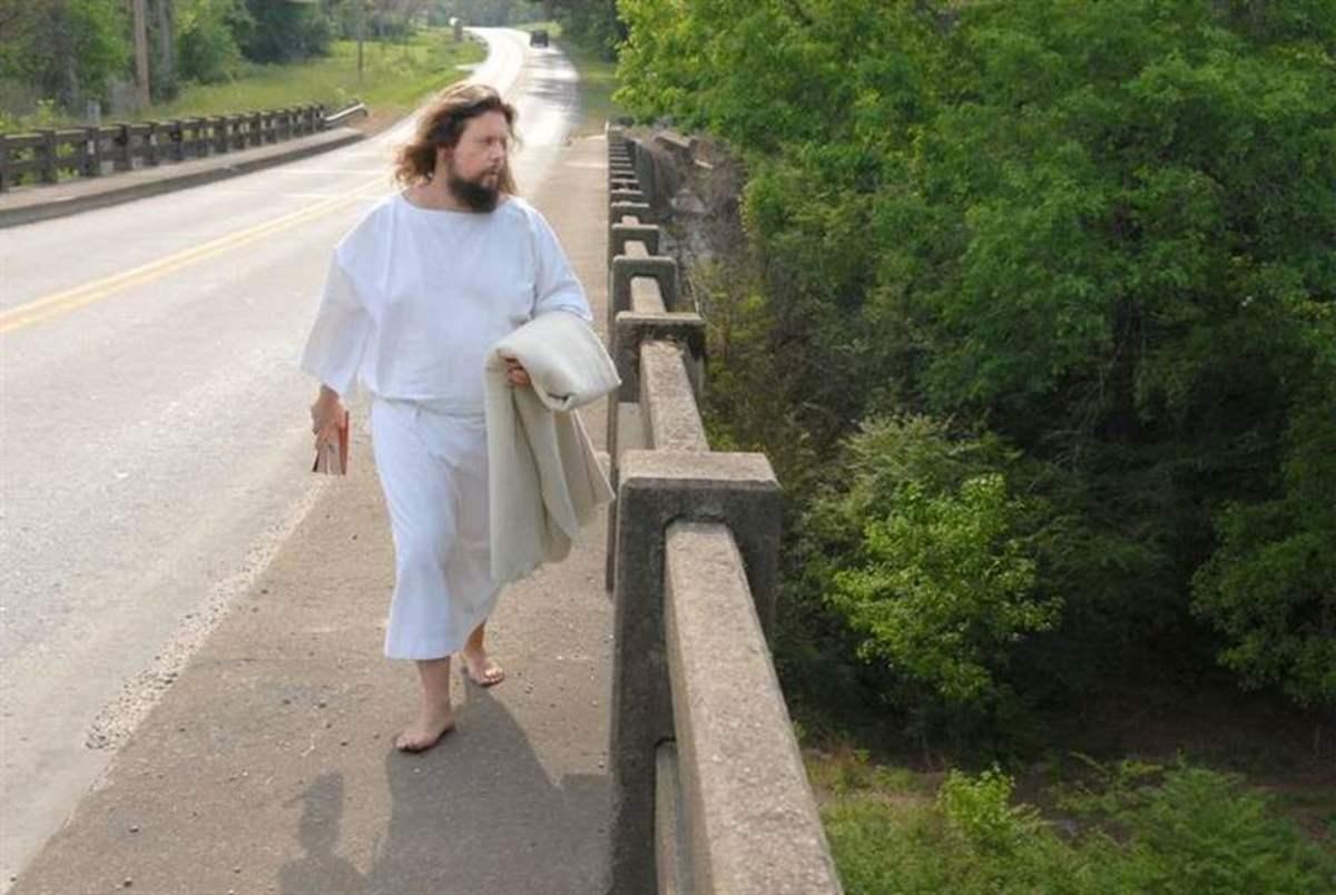 Carl Joseph aka The Jesus Guy walking barefoot down a road in Ohio