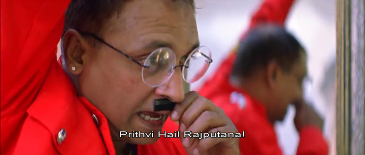 A scene in the movie when he waves at his brother putting this moustache on his lips to portray that his brother has the ideologies of that of a Hitler.