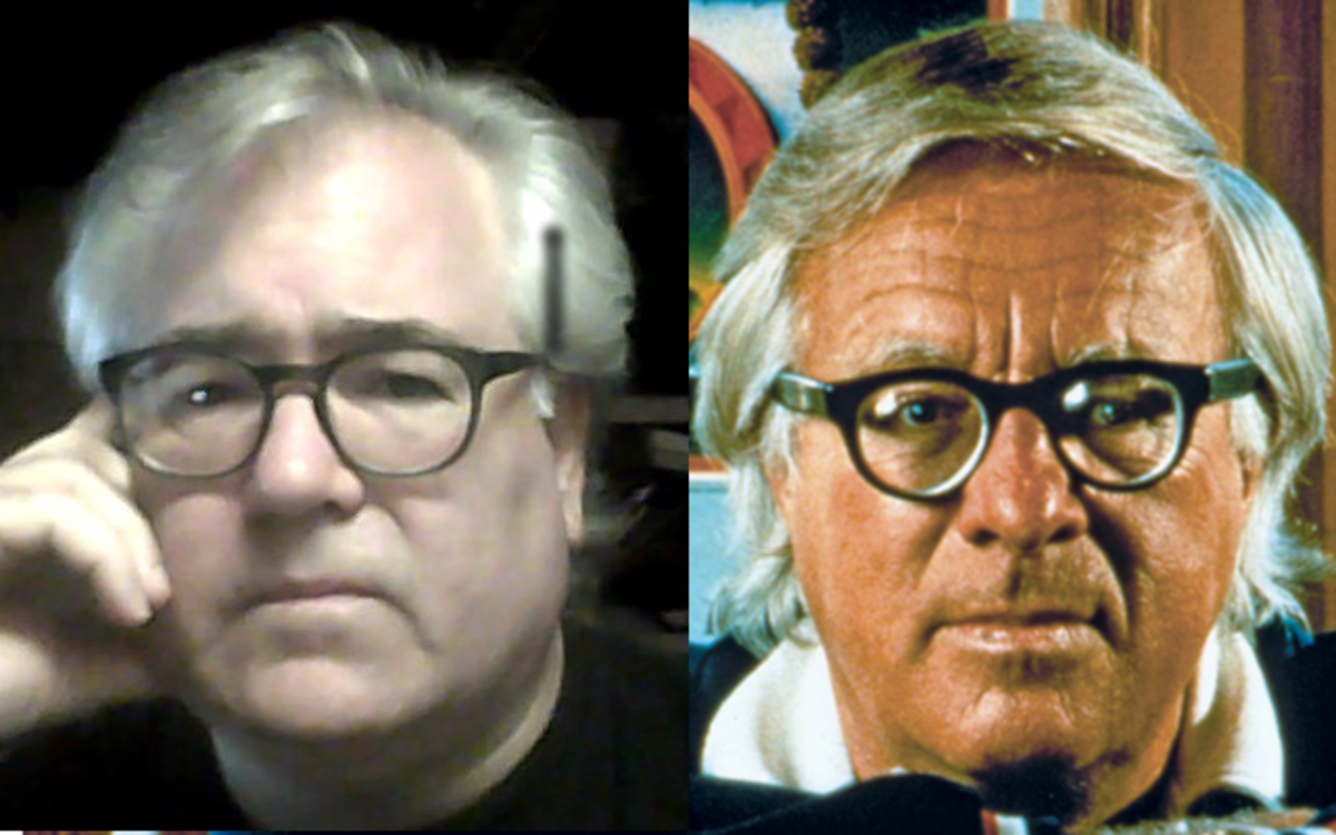 I'm slowly transforming into Ray Bradbury.  I'm on the left, Bradbury is on the right.