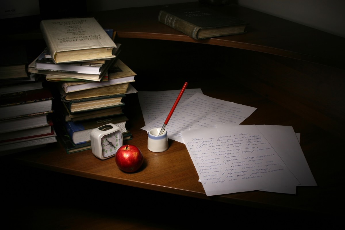 Books and written notes in a table(ink well letter)