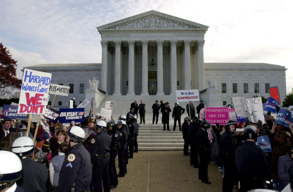 Supporters of George W. Bush and Al Gore gather in front of the US Supreme Court on December 1, 2000, only 11 days before the ruling of the landmark case Bush v. Gore was announced in a 5-4 decision
