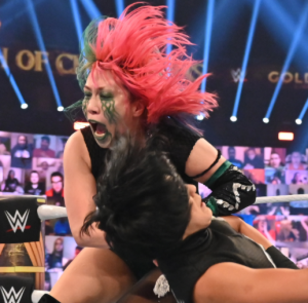 Asuka running through Bayley in a Champion vs Champion match for Bayley's precious championship.