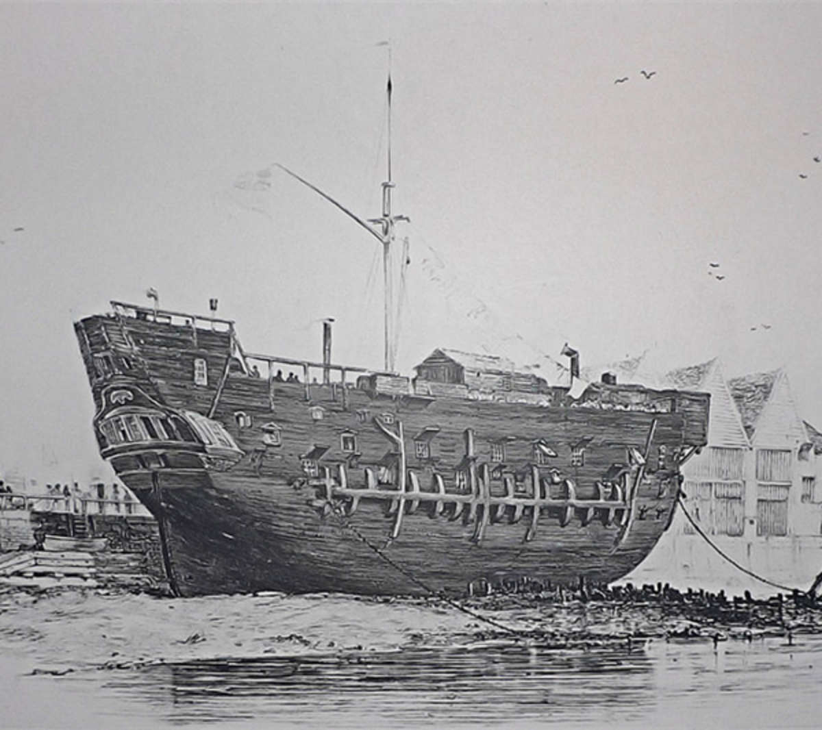 The beached convict ship HMS Discovery at Deptford. Launched as a 10-gun sloop at Rotherhithe in 1789, the ship served as a convict hulk from 1818 until scrapped in February 1834.