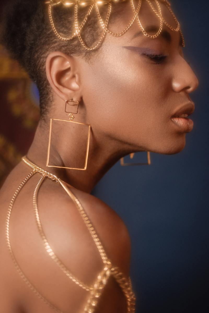 Big chunky gold jewelry.