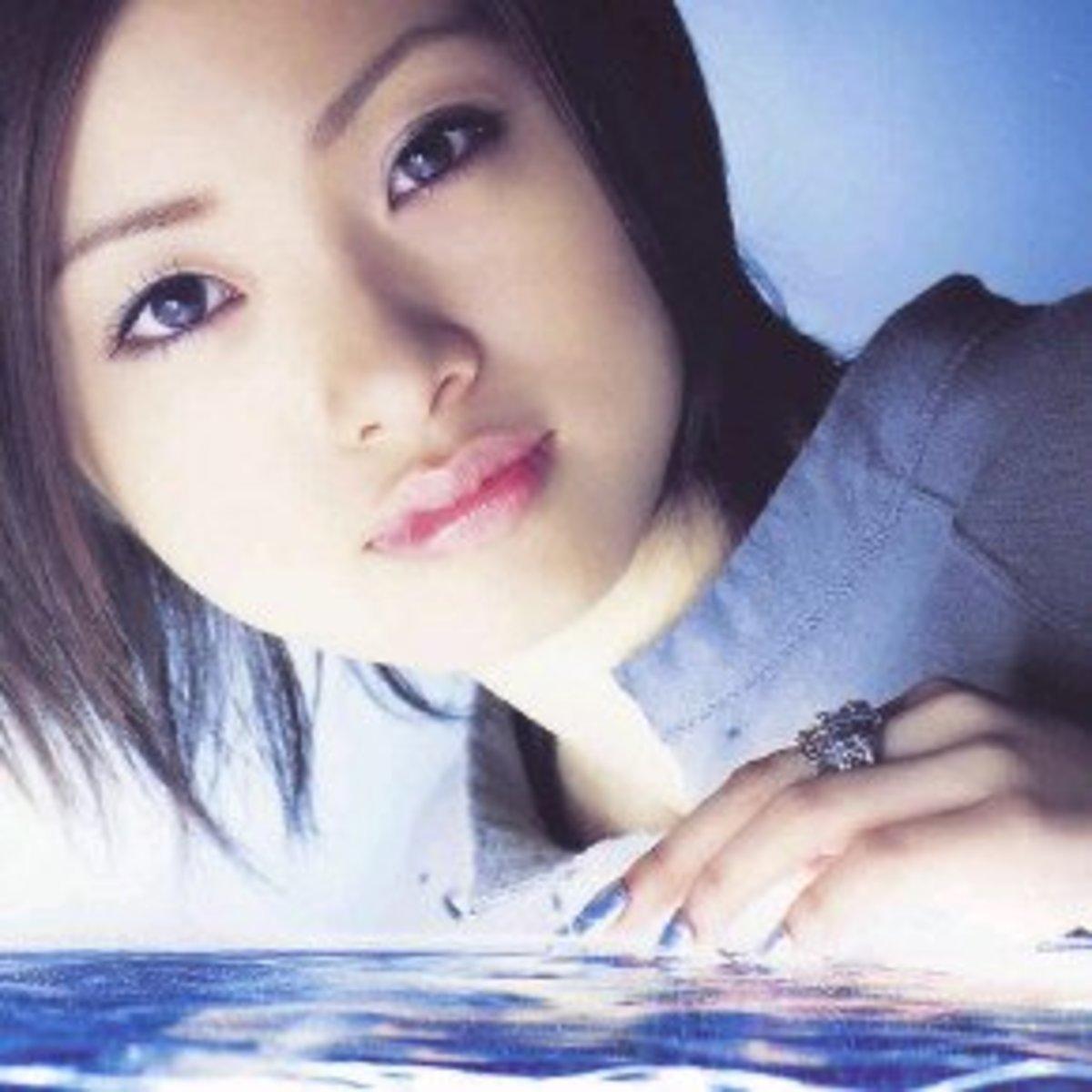 Japanese male wearing lip gloss.