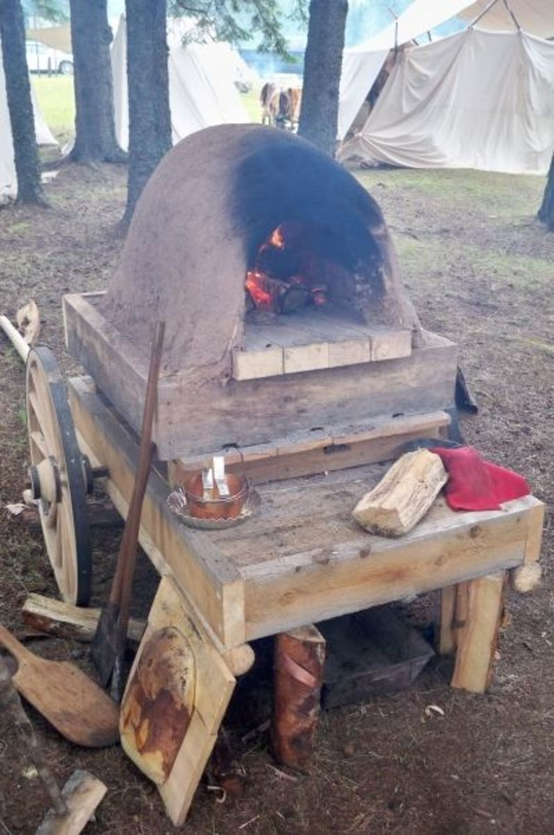 Heating up the clay oven to bake bread and pies