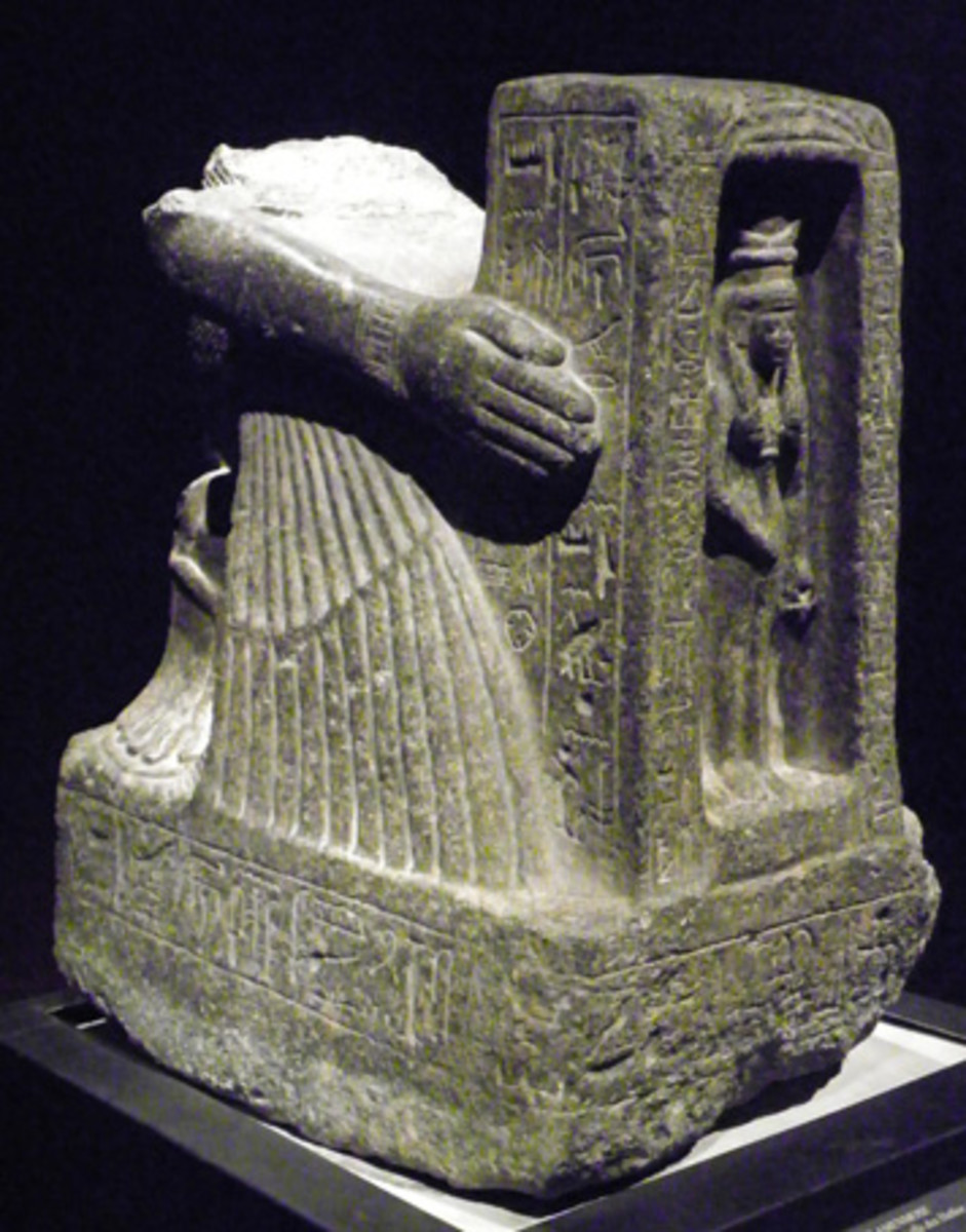 Statue of the priest Amenmose, 11th cent. B.C. He kneels and holds the chapel with Goddess Hathor (Turin, Egyptian Museum)