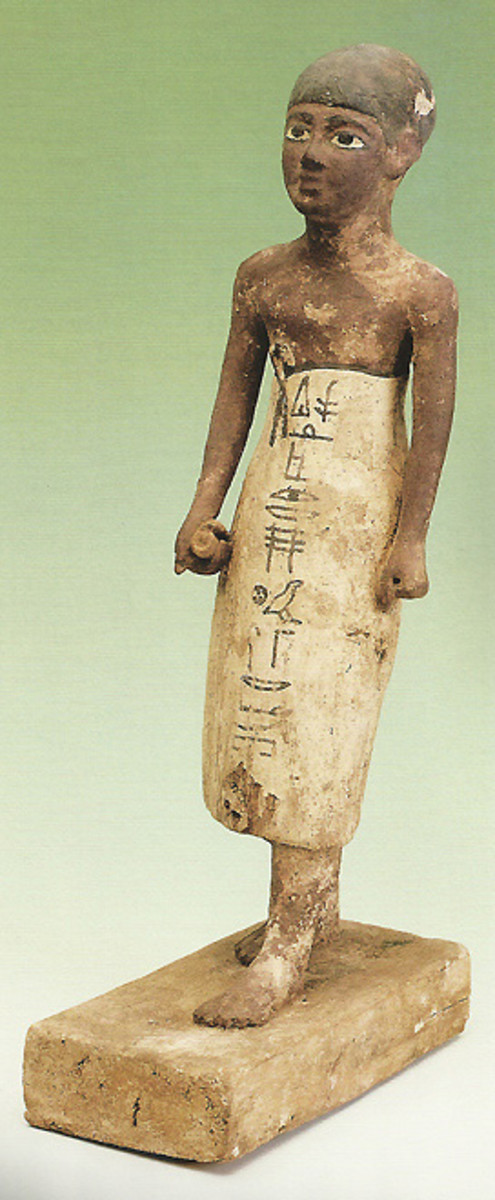 A Priest with a papyrus scroll in his right hand; on his skirt the first words of a prayer to Osiris(Middle Kingdom)