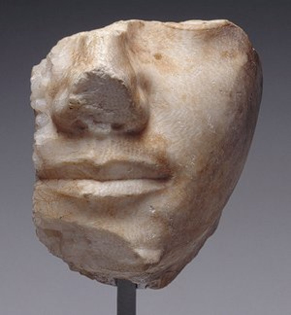Fragmentary face of King Khafre. It displays - even at a small scale - the subtle and very sensitive modeling and finely finished surfaces of these masterpieces of Old King royal sculpture