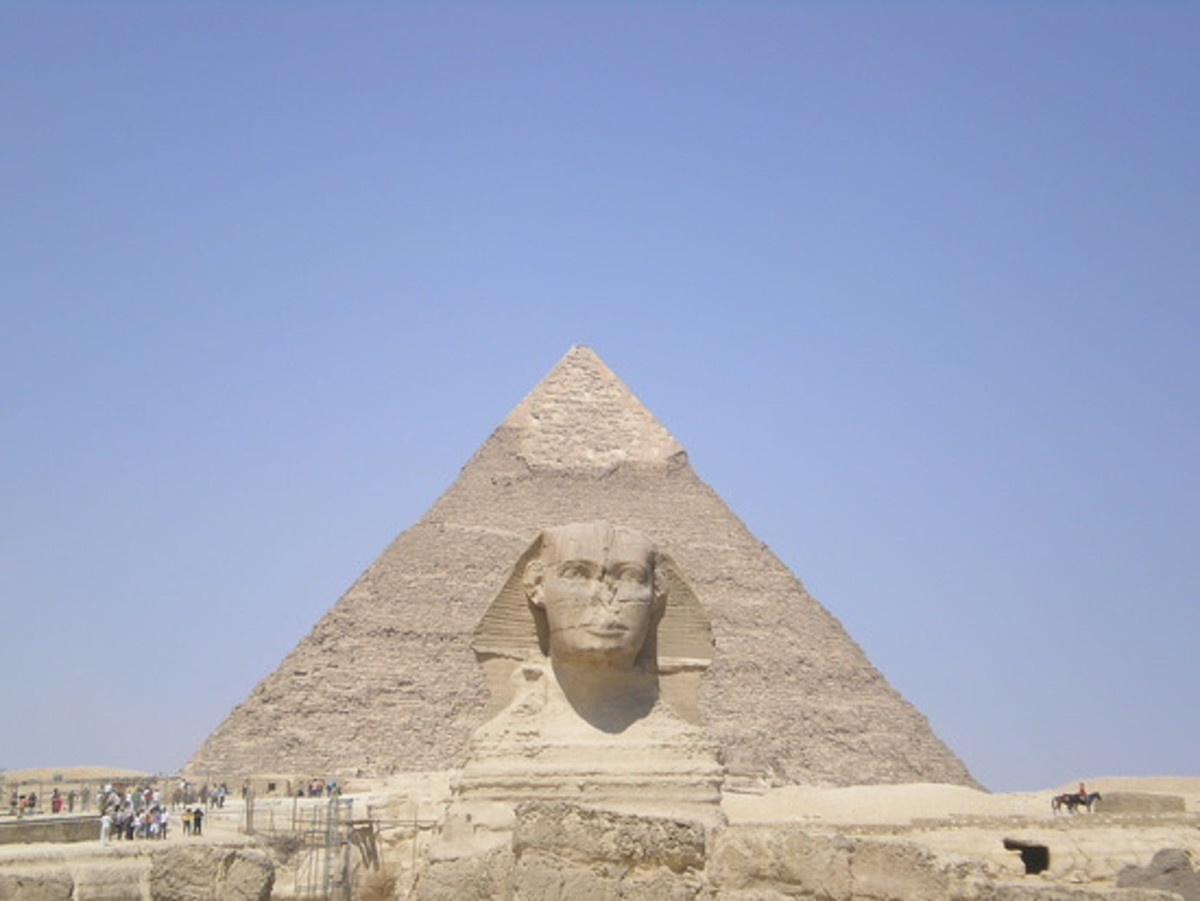 The Sphinx and the Great Pyramid in the Background. The Sphinx guards the Number One Ancient Wonder of the World.