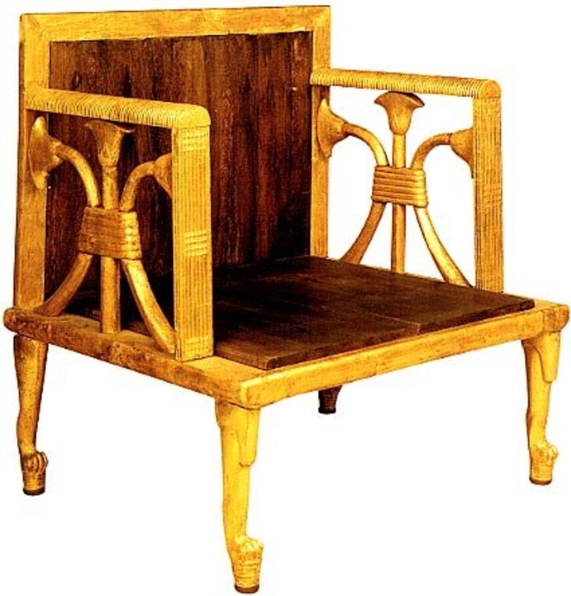 Gilded Queen's wooden armchair