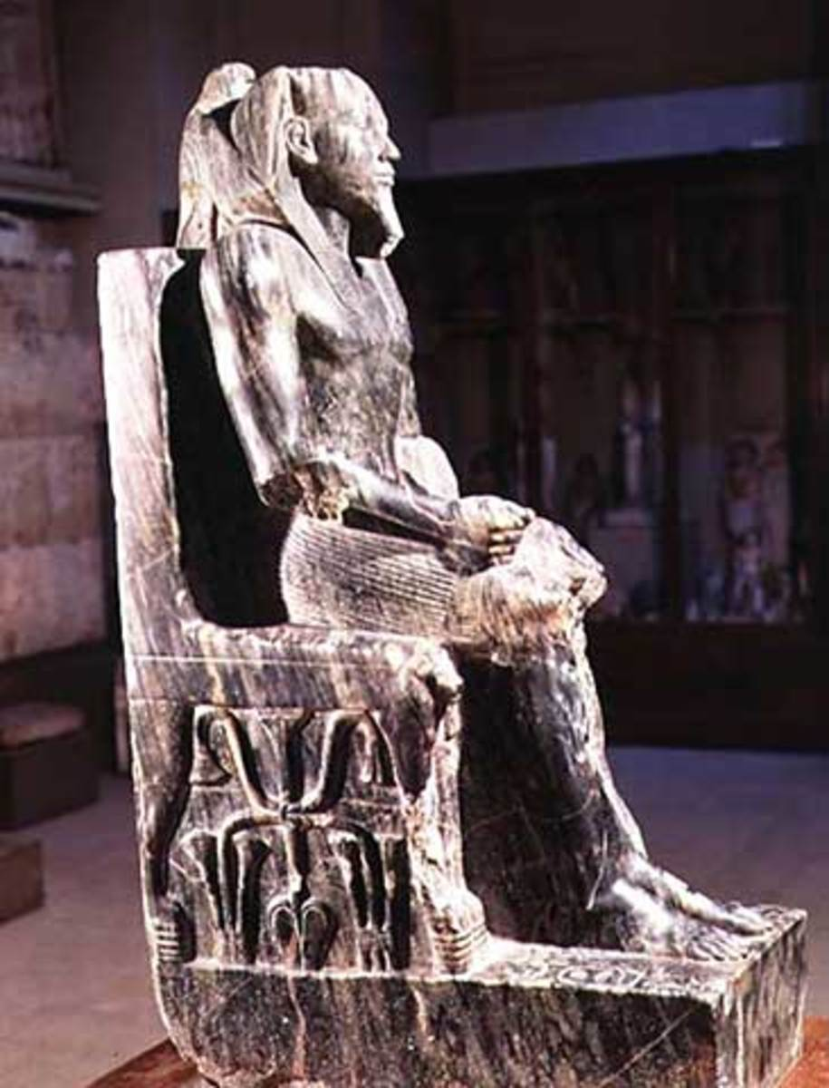 Seated,  Statue of Khafre(Cephren), at Giza, Old Kingdom - Dynasty IV. He was the son of Khufu, builder of the Great Pyramid.