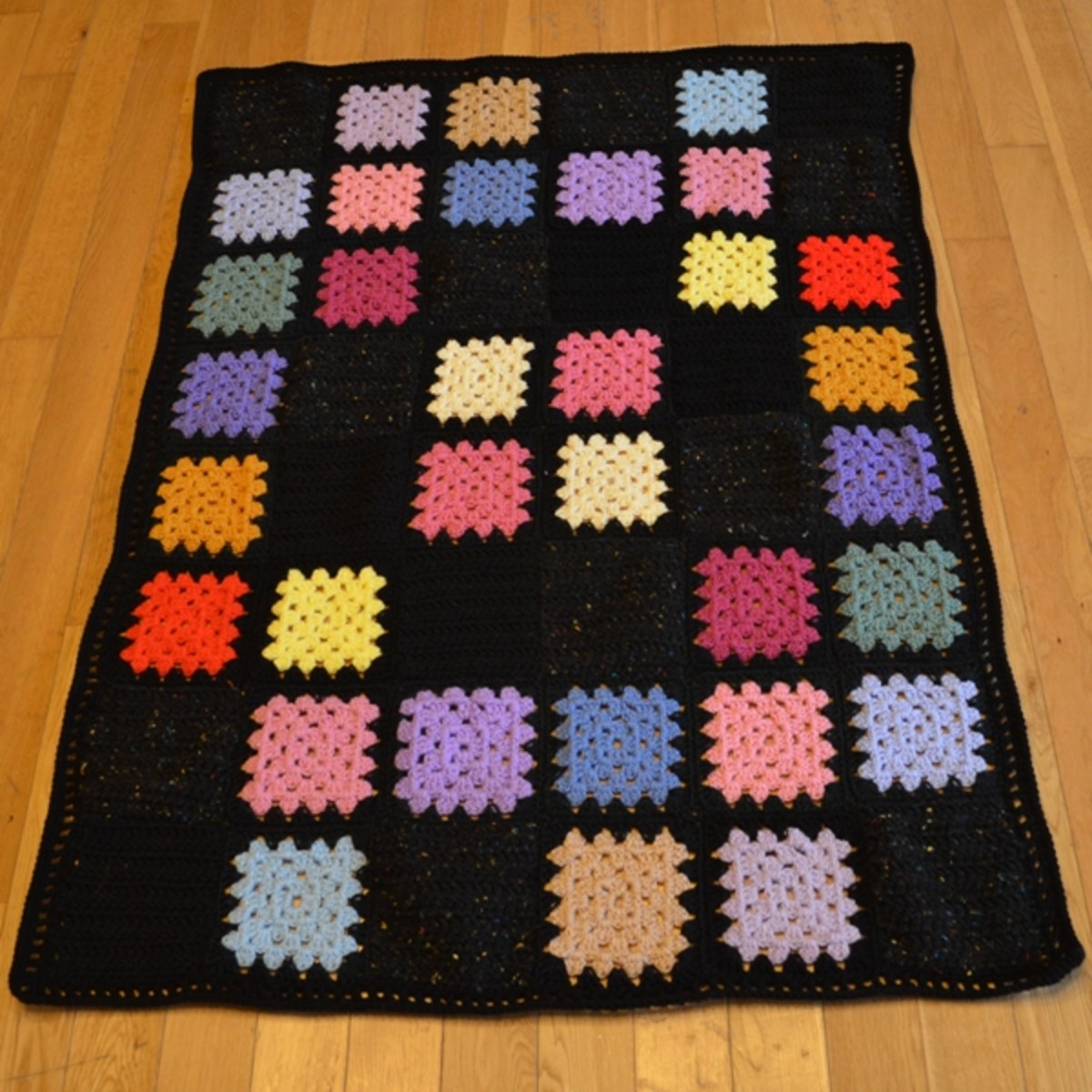 This black afghan also uses the DC - CH 1 border.