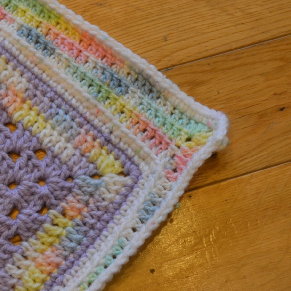 Pastel colored baby afghan border showcasing different colors.