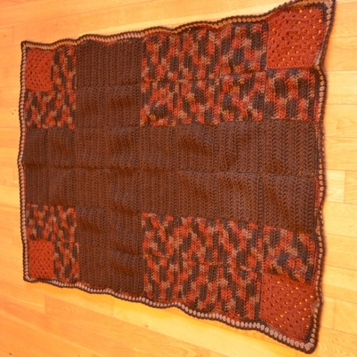 Finished autumn-colored afghan with cross pattern.