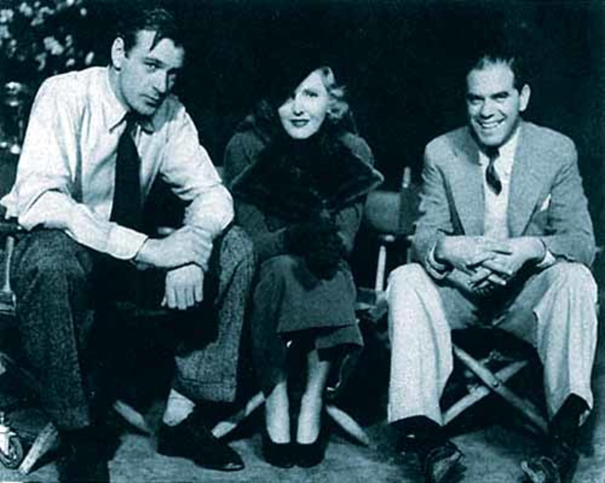Jean with Gary Cooper (left) and Frank Capra