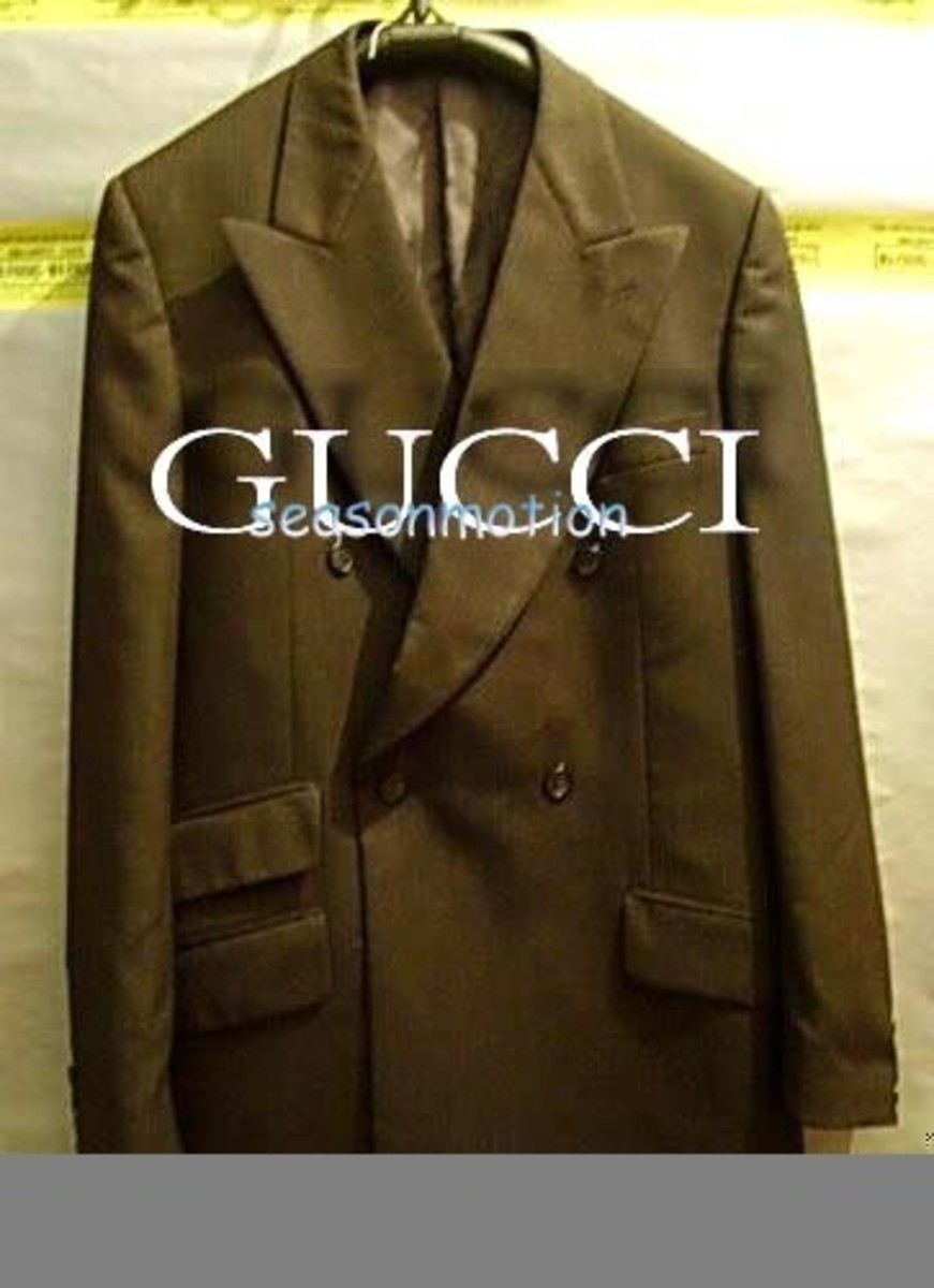 "For Sale:"" Gucci suit, tailored to fit and yes, we deliver."""