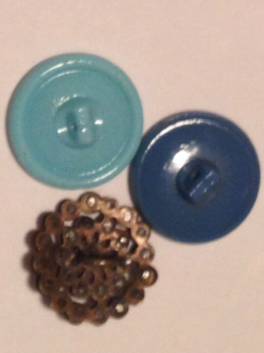 Pictured above, blue glass Czech self-shank buttons.