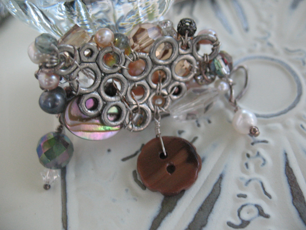 Here you can see the back side of the brooch pictured above.  I used 24 gauge wire to secure the beads in place and hold the pin backing on.  The higher the number for a wire's gauge, the thinner the wire.